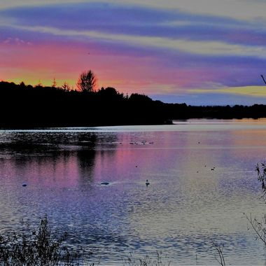Sunset on the local loch all the colours reflecting on the water amazing !
