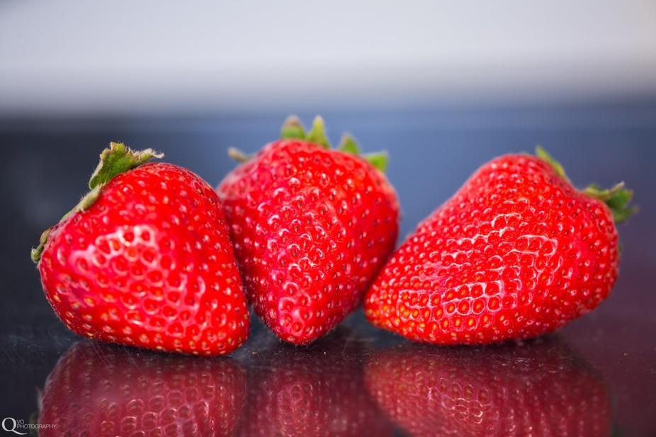 Strawberries on glass.