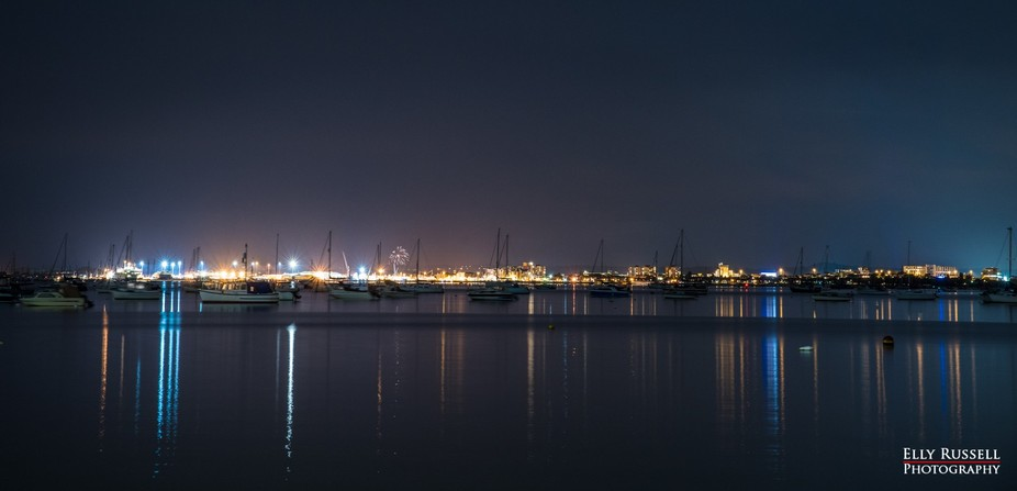 Poole Harbour, taken from Sandbanks Road at night - with a lucky firework shot in the background!