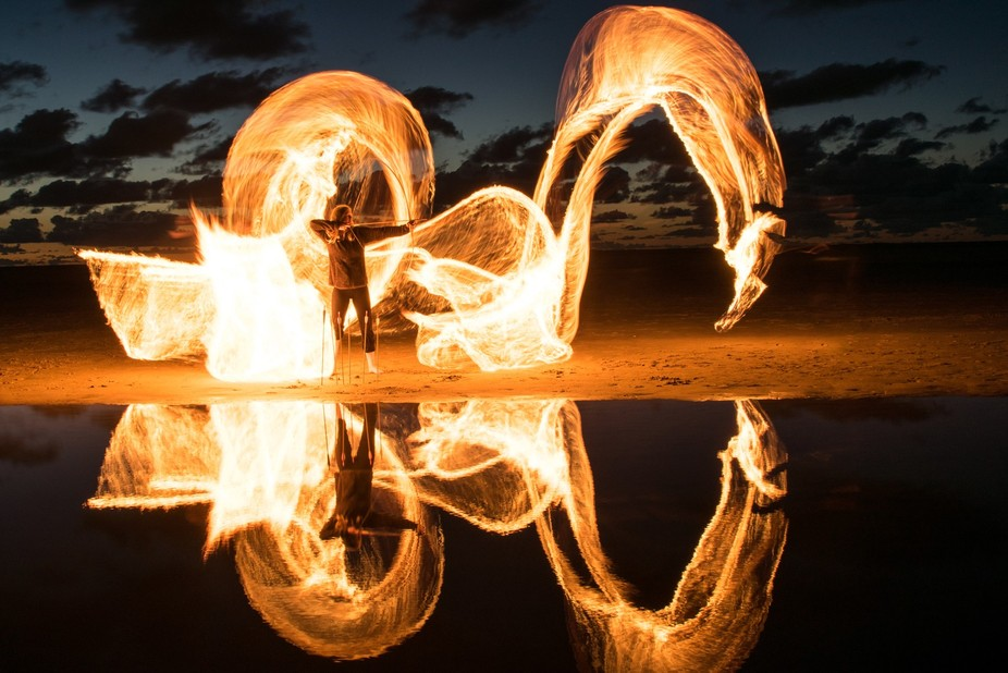 Another night on the beach - with a fire dragon and an archer.  Long exposure with an oil-soaked ...