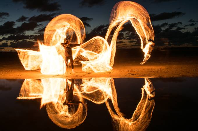 Another night on the beach - with a fire dragon and an archer.  Long exposure with an oil-soaked burning rope.