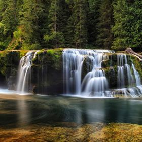 This picture captures the morning light illuminating the lower falls of Lewis Creek located in the Gifford Pinchot National Forest, Washington State.