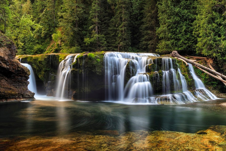 This picture captures the morning light illuminating the lower falls of Lewis Creek located in th...