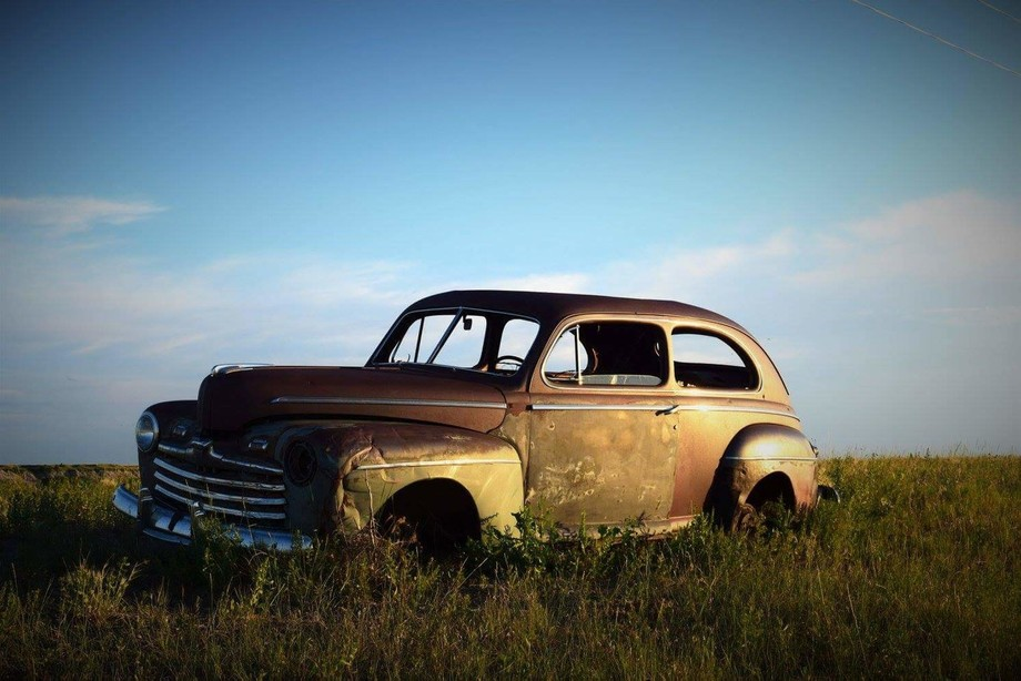 Rusty car in the middle of no where