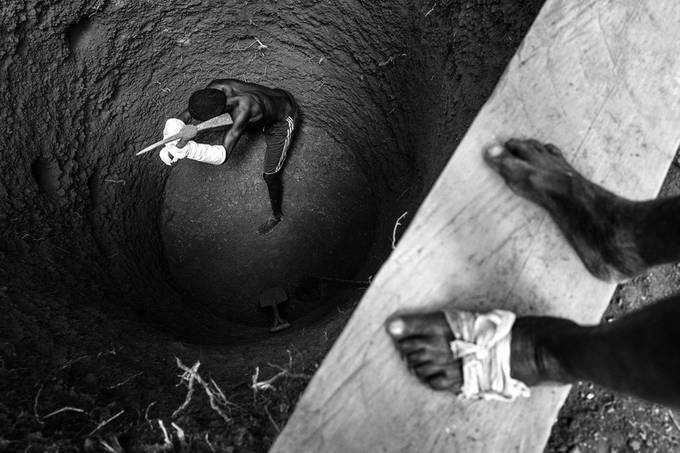 Building a well by germanomiele - People At Work Photo Contest