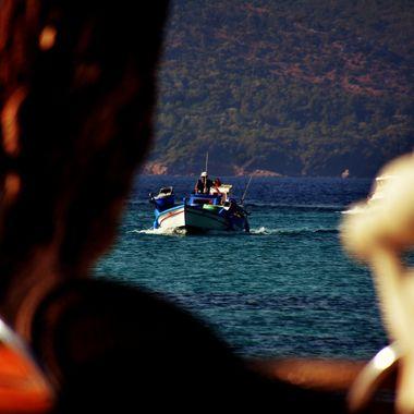 Small fishing vessel returning to Posidonio Bay.