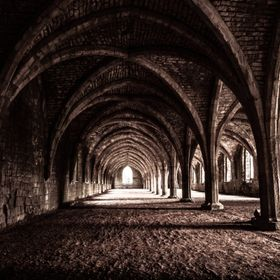 Fascinating arches inside enchanted old castle