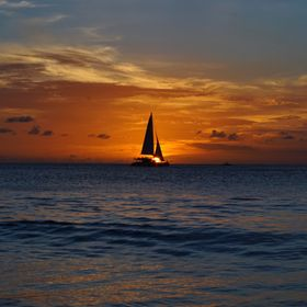 Sailing boat silhouette at sunset