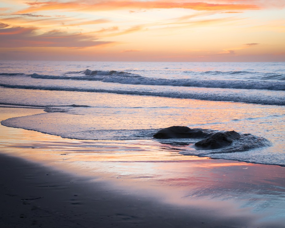 Nikon D7100  Shades of pinks, purples, and orange in this heavenly stretch of peaceful coastline....