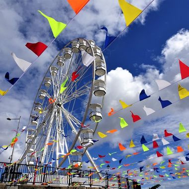 First ever visit to Cardiff Bay on a lovey day loving all the coloured bunting around the big wheel and the contrast against the stunning sky !