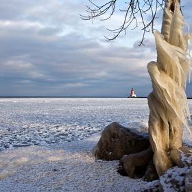 Taken Dec. 31, 2015 at the Menominee Pier Lighthouse during very high winds, freezing temps, and snow from Winter Storm Ashley that came from the...