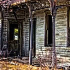A very old and weathered and worn farm house out in the country of Wisconsin. Done in a slight HDR process.