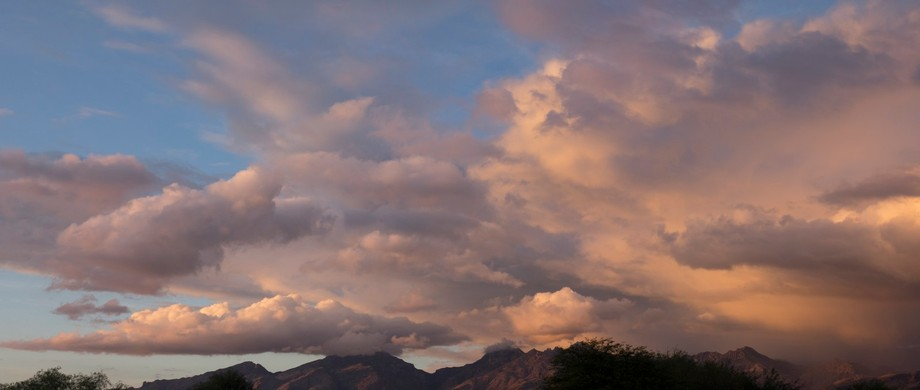 A strom arrives over the mountains near Tucson