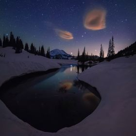 Mount Rainier under a gorgeous night sky and some lenticular clouds.