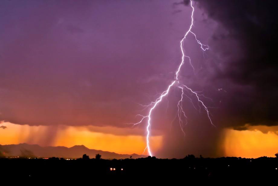 Sunset monsoon cell with lightning strike