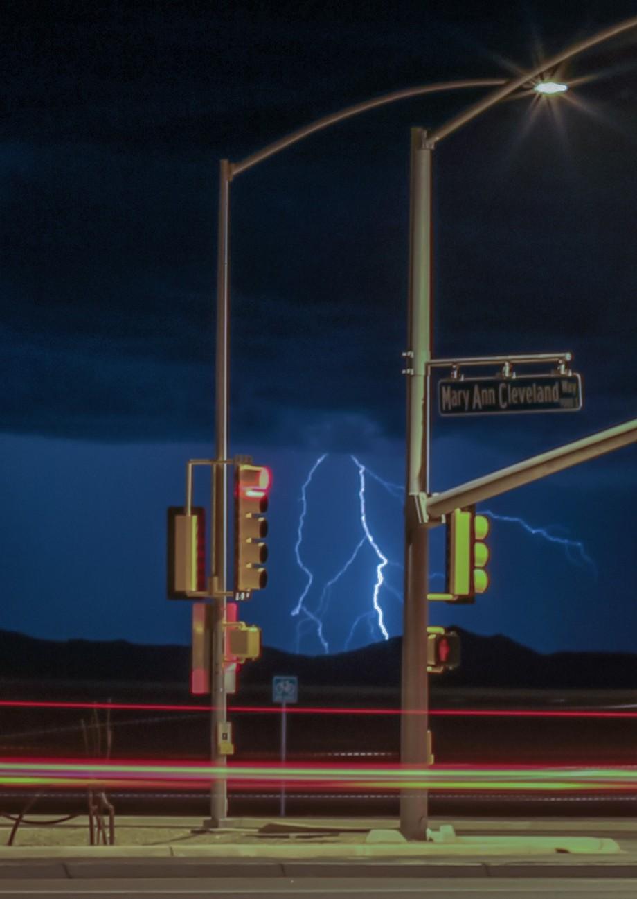Between two traffic light poles something else lights up.