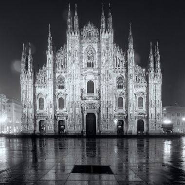 "A rainy evening at the Duomo in Milan. Have you ever wondered what in the world the differences between a Duomo, basilica, cathedral and a chiesa? These terms are used all over Europe.   Let's start with basilica. The Latin term has three applications in modern English. The word was originally used to describe an open, Roman, public court building, usually located adjacent to the forum of a Roman town. By extension it was applied to Christian buildings of the same form and continues to be used to describe those buildings with a central nave and aisles. Later, the term came to refer specifically to a large and important church that has been given special ceremonial rights by the Pope.  A cathedral (Latin cathedra, ""seat"") is a Christian church that contains the seat of a bishop, thus serving as the central church of a diocese. Duomo is synonomous with cathedral in Italian, although nowadays it can refer to either a current or former cathedral. The latter could occur if the town no longer has a bishop. And some duomos, although old and important churches, have never actually been cathedrals. The word duomo probably derives from the Latin word ""domus"", meaning house, as a cathedral is the ""house of God"", or domus Dei.  Finally, chiesa. This is simply Italian for ""church"". So if you're unsure, you can always use this term safely!"