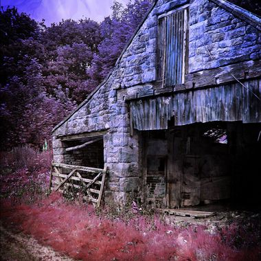 An old ram shackled barn in hdr.
