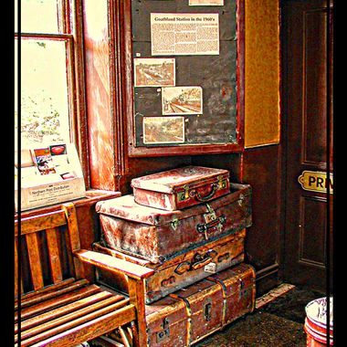 Old dusty cases at an exhibition railway station.