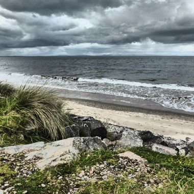 Lifes a Beach , even on a wet September day. Looking over the Moray Firth across towards Sutherland.
