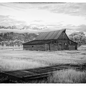 The iconic TA Moulton Barn is located at Grand Teton National Park on Mormon Row near Moose, Wyoming USA.  (Moose is north of Jackson Hole.)   10...