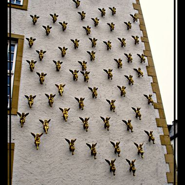 Lots of mini angels attached to wall in Paderborn, Germany.