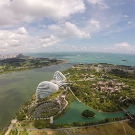 Beatiful shot taken from the observation deck of Marina Bay Sands. You can see the Gardens by the Bay and Supertree Grove from this vantage point.