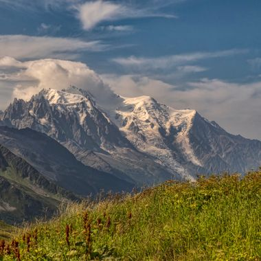 The Mont Blanc Massif seen with characteristic cloud from the Col de Balme at the head of the Chamonix Valley