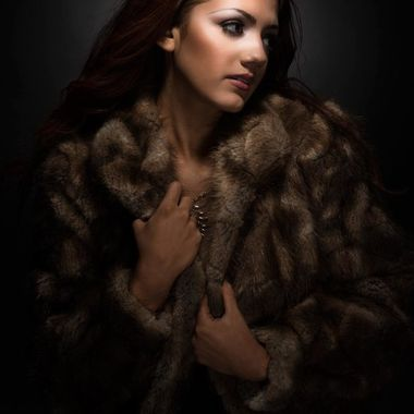 Model Kristen wearing beautiful mink coat. Shooting in studio with specially designed lighting technique of my own.