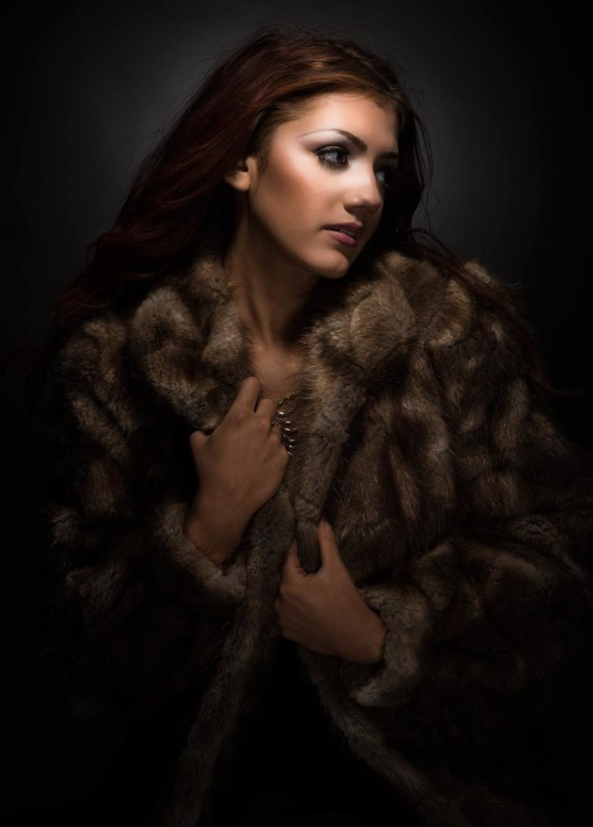 Model Kristen wearing beautiful mink coat. Shooting in studio with specially designed lighting technique of my own.