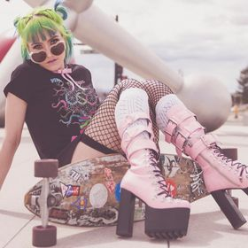 Skater Chick posing with platform boots.