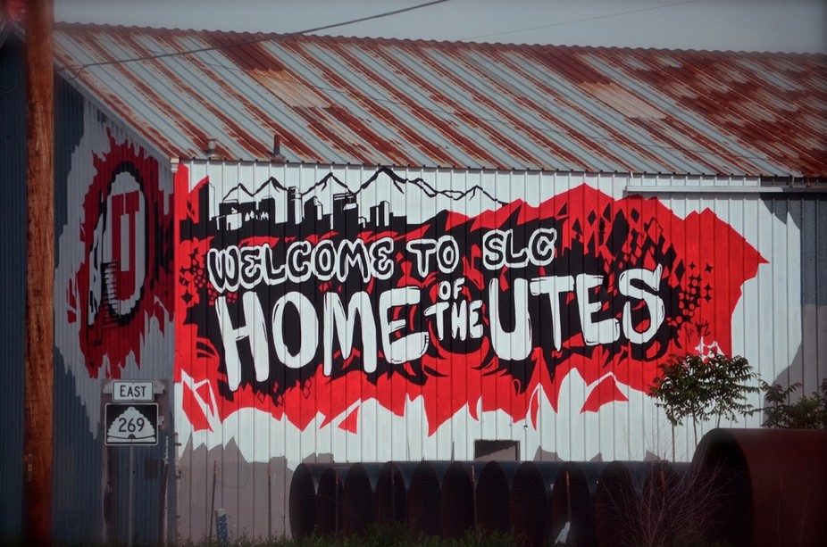 Coming off I-15, east into the center of Salt Lake City, this graffiti welcome sign greets you to...