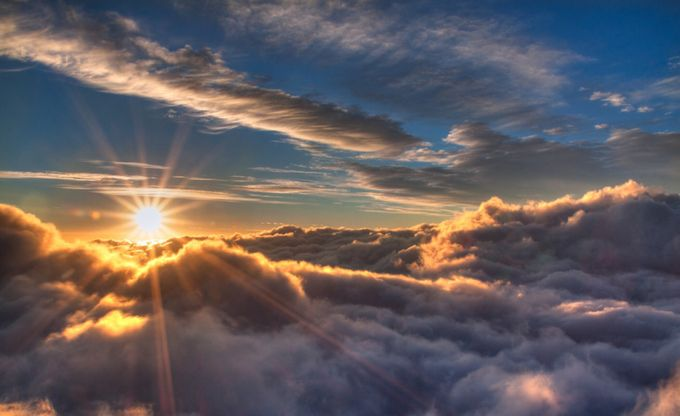 Sunrise above the clouds! by kimpaffen - The First Light Photo Contest