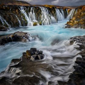 A delightful cascade with glacial blue water