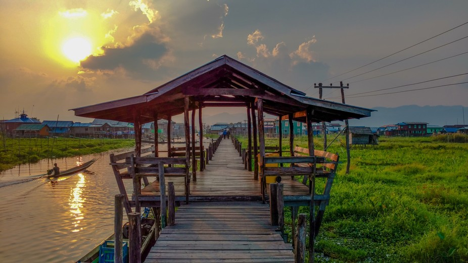A bridge in a small village over the Inle Lake in Myanmar at sunset.
