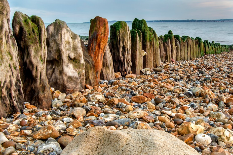 A weathered groyne on the beach at Stokes Bay on the Solent