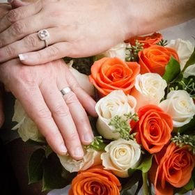Some of the wedding pictures I took for a friend of mine. This is the wedding rings overlaid hands on the bouquet.  Had an absolute blast doing m...