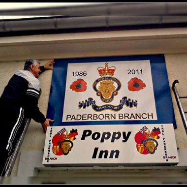 Putting up the new club sign back in 2011.