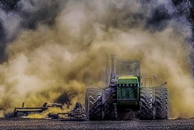 An Oregon Farmer Plows His Field