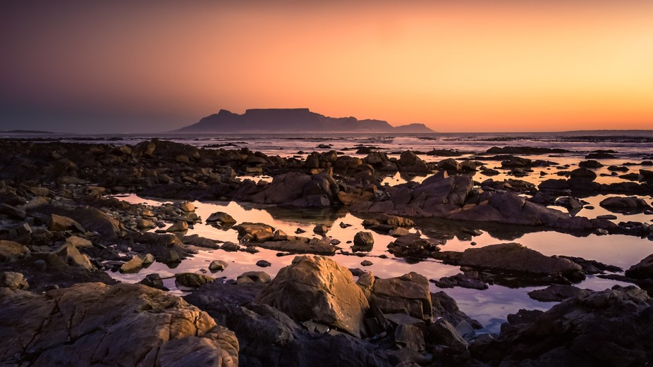 Table Mountain (Afrikaans: Tafelberg) is a flat-topped mountain forming a prominent landmark over...