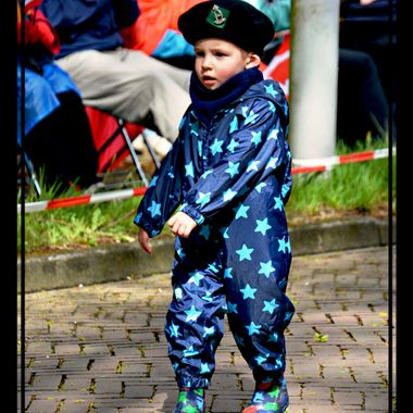 Young Dutch boy on parade with the veterans.