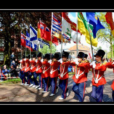 Girls bearing banners on parade.