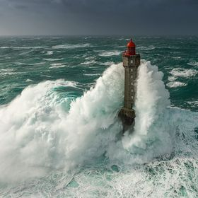 This image was taken during a storm in Brittany with 15m high waves and 140 km/h of wind. The lighthouse is 47m high ... what a wave !