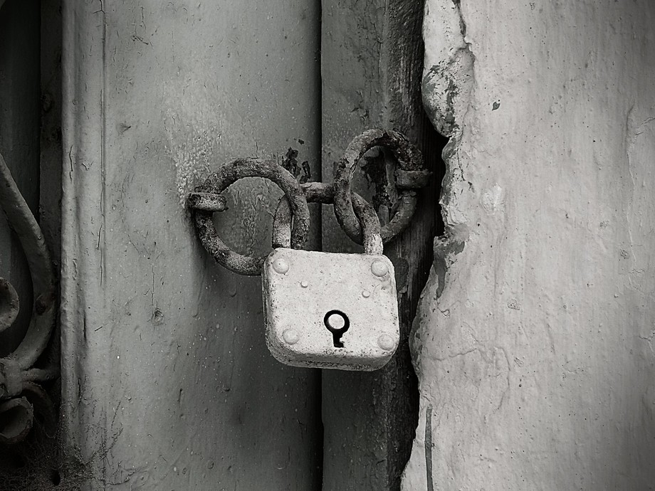 An old door; spiderwebs and rust and chipped paint; and yet, nothing's sadder than that lock.