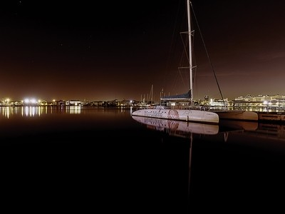 Night yacht reflections