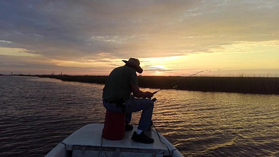 A Man Fishing at Sunrise