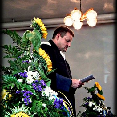 Padre conducting a church service.