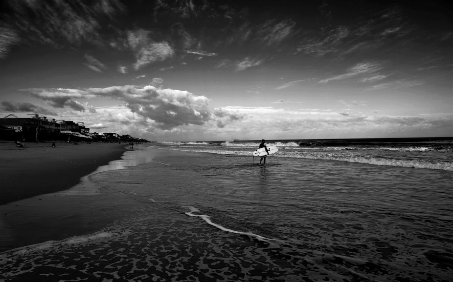 Up to 10 foot waves attracted surfers to the beaches off of North Carolina while hurricanes churn...