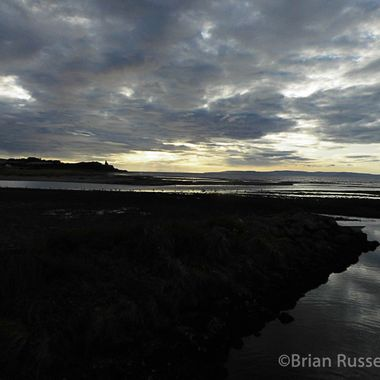 Greenan castle and beach at dusk from by the River Doon at Ayr