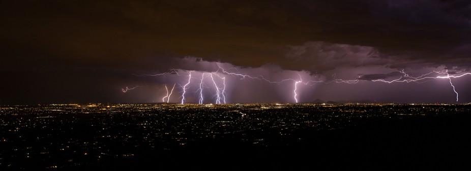 severe lightning storm over a city
